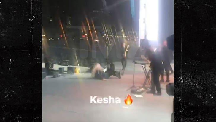 Kesha Falls Hard on Stage During Concert