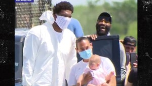 Joel Embiid Rocks Hazmat Suit To NBA Bubble, Safety First!