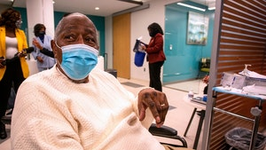 Hank Aaron Gets COVID Vaccine, Hopes to Inspire Black Americans to Follow Suit