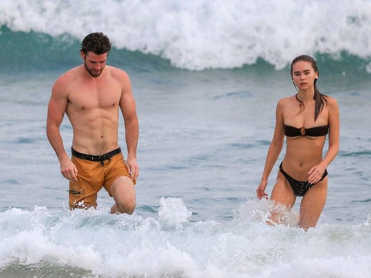 Liam Hemsworth & GF Gabriella Brooks Show Off Toned Bods at the Beach