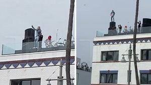 MGK, Travis Barker's Rooftop Performance Looked Kinda Dangerous