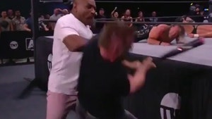 Mike Tyson Drops AEW's Cash Wheeler With Haymaker During Ringside Beatdown