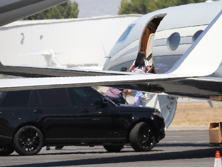 Kylie Jenner & Travis Scott Seen Boarding Plane With Wedding Dress