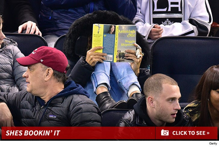 SJP reads a book at Rangers/Kings game