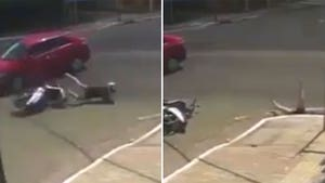 Moped Rider Hit by Car Falls Straight into Storm Drain, Worst Luck Ever