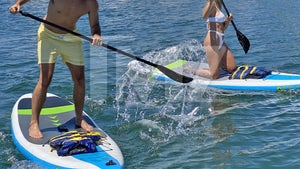 Bryce from 'Too Hot to Handle' Paddleboards with Model Khloe Terae