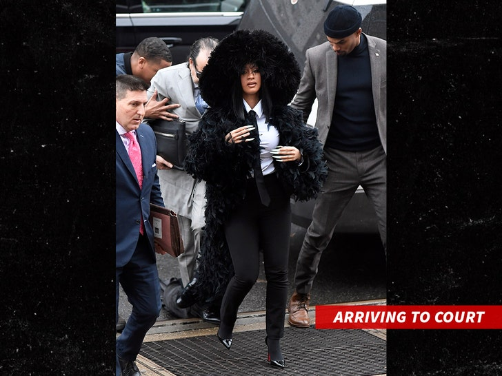Cardi B shows up at Queens court dripping in feathers