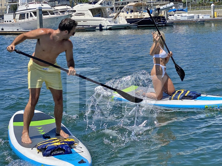 Bryce from 'Too Hot to Handle' Paddle Boards with Model Khloe Terae