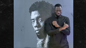 Artist Creates Amazing Rose-Painted Mural of Chadwick Boseman