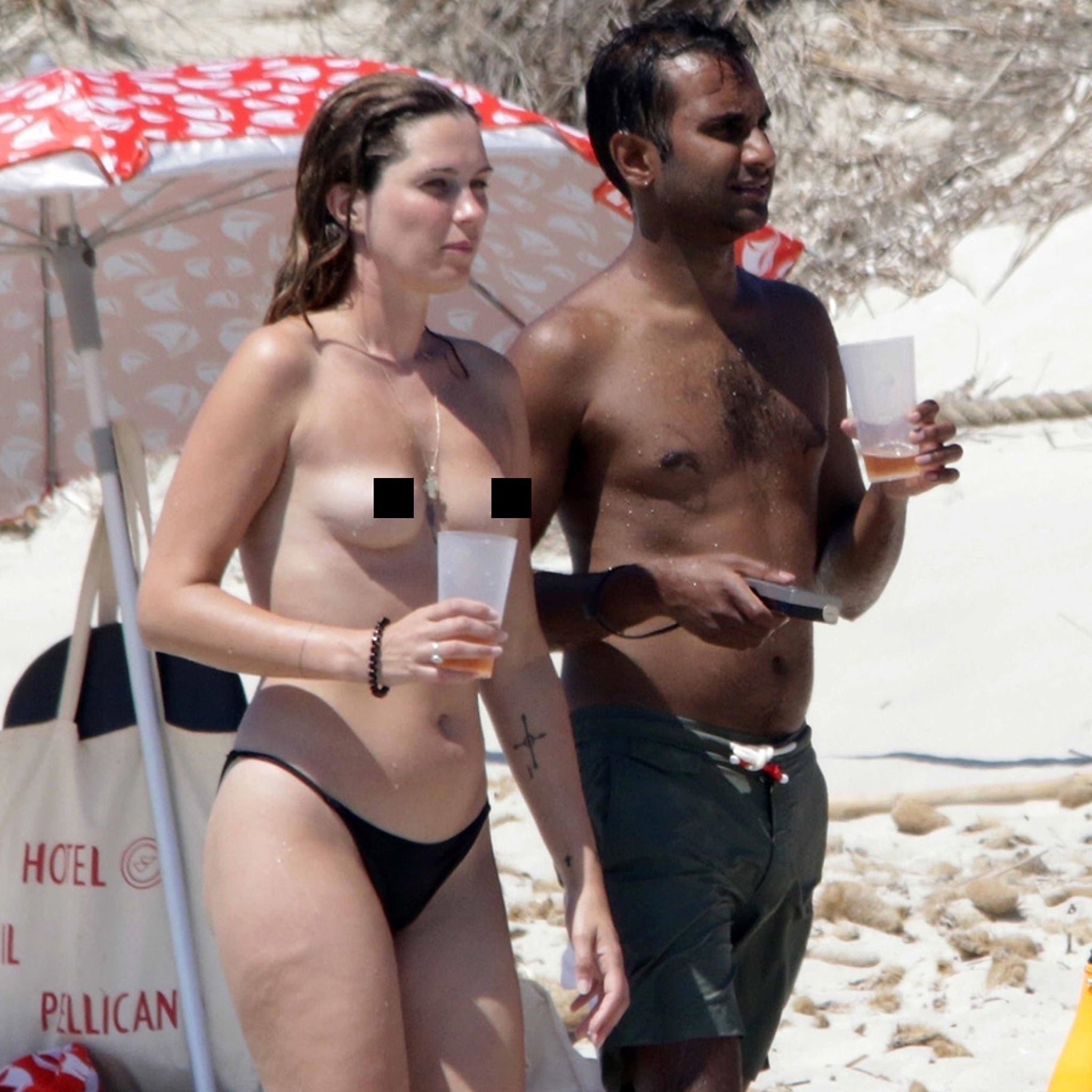Aziz Ansari Hits Spanish Beach with Topless Girlfriend