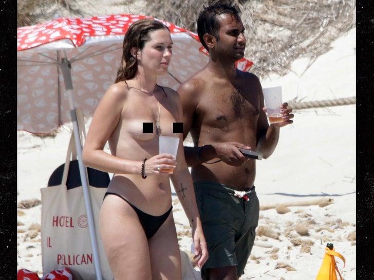 Aziz Ansari Hits Spanish Beach with Topless Girlfriend