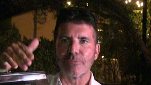 Simon Cowell Breaks His Back On Electric Bike, Surgery Required