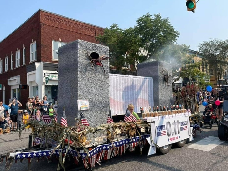 9/11 Parade Float with Models of Twin Towers with Billowing Smoke Triggers Outrage.jpg