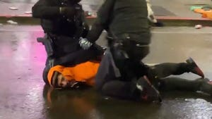 Cop Removes Fellow Cop's Knee from Protester's Neck