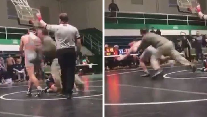 Dad charged after tackling son's opponent at HS wrestling match