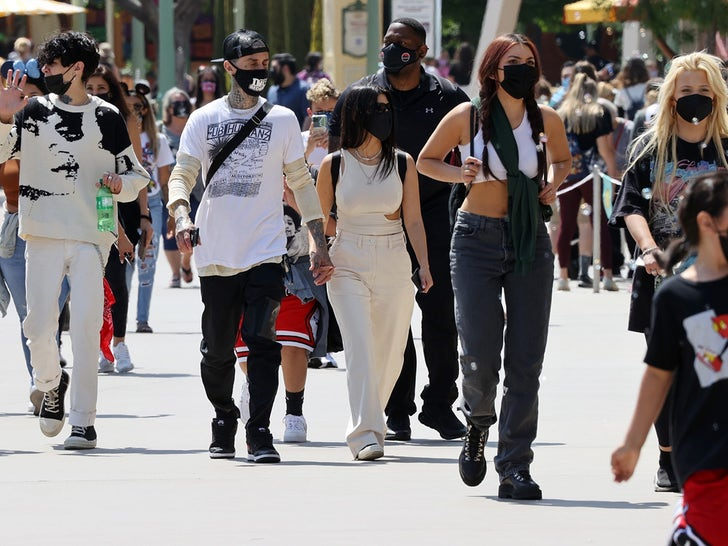 Kourtney Kardashian and Travis Barker Take the Fam to Disneyland