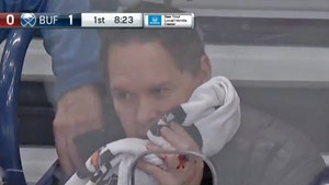 NHL Photog Hit By Puck, Bloodied From Insanely Unlikely Shot