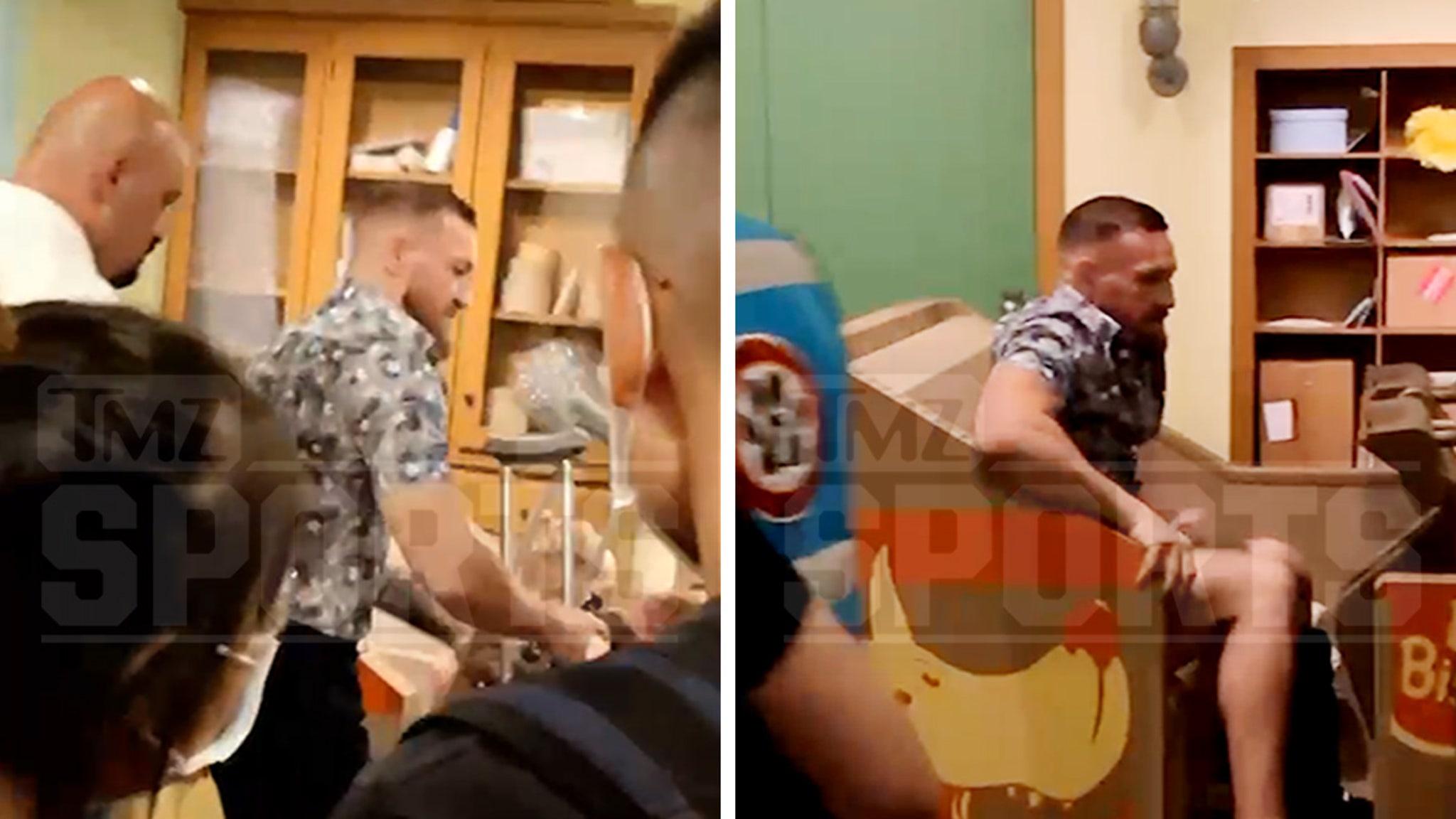 Conor McGregor Hits Universal Studios on Crutches