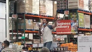 Anti-Masker Grabs Megaphone, Climbs Display to Rant Inside Costco