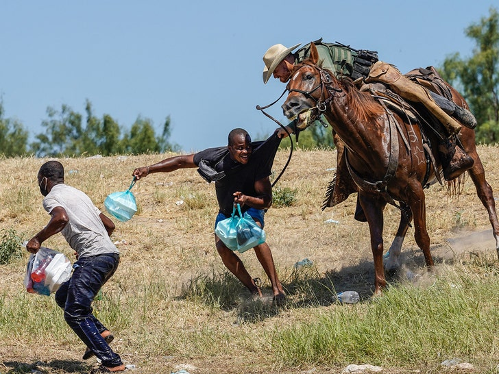 Border Patrol Agents Seem to Use Horse Reins As Whips Against Haitians.jpg