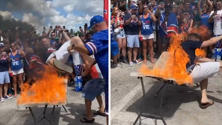 Bills Fans Throw Guy Onto Table Set on Fire Ahead of Miami Game.jpg