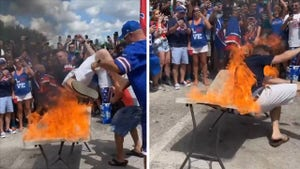Bills Fans Throw Guy Onto Table Set on Fire Ahead of Miami Game