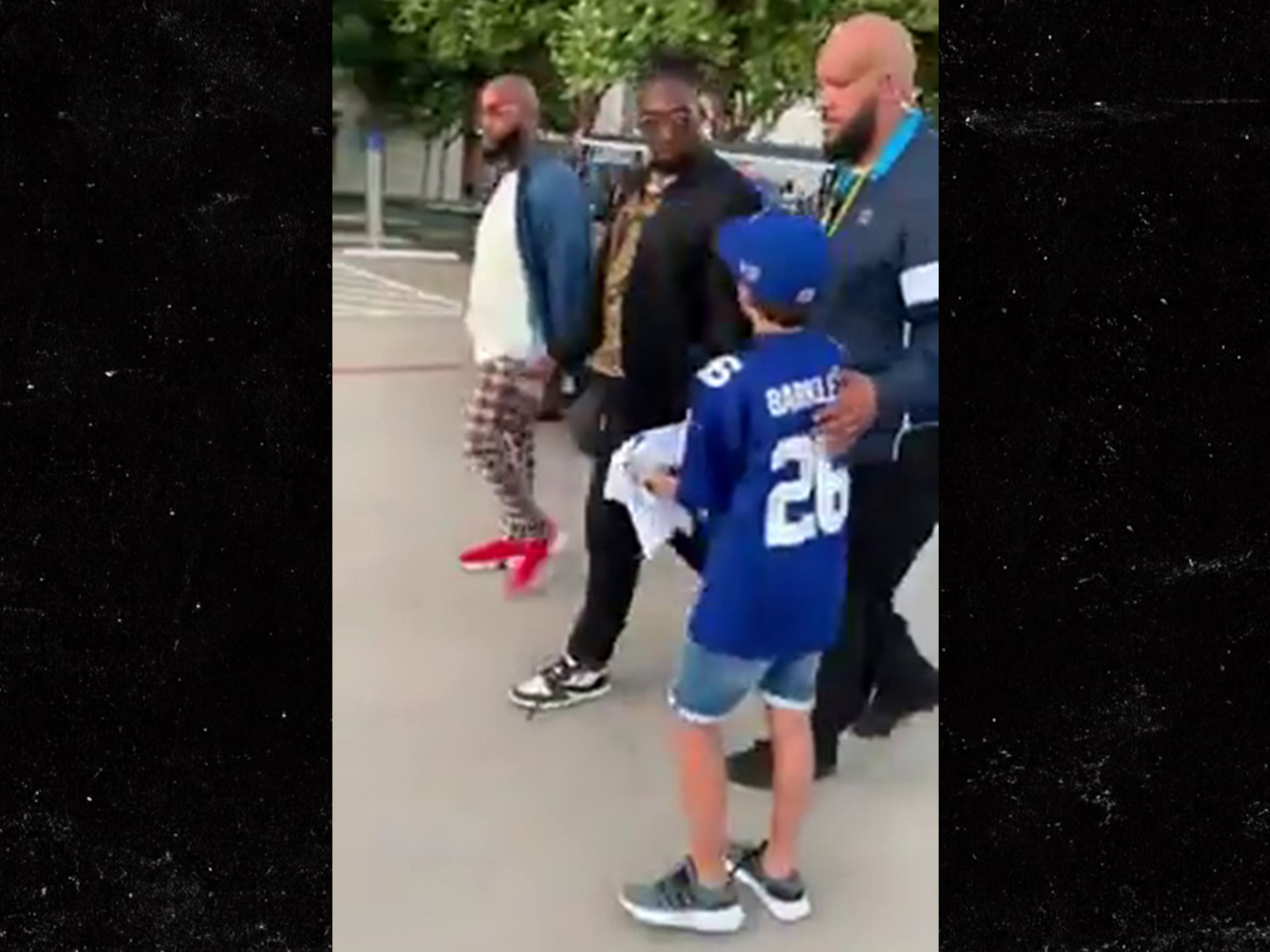 NFL's DeMarcus Lawrence Defends Roasting Kid, 'Get The Right Jersey, Son!'