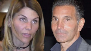 Lori Loughlin Keeping Her Head Down, Husband Still in Quarantine