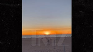 Sun Sets on 2020 in L.A. as Beachgoers Cheer and Applaud