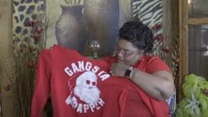 Mom Claims Black Son Denied Medical Service Over 'Gangsta' Santa Shirt