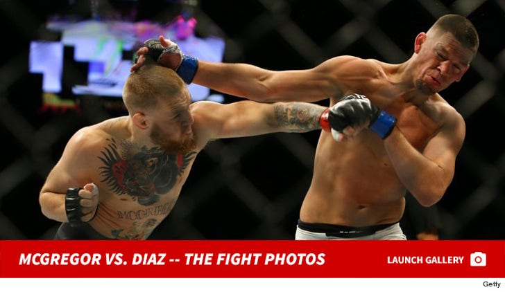 Conor McGregor vs. Nate Diaz -- The Fight Photos