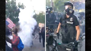 Seattle Police and Protesters Clash in Cloud of Smoke Bombs and Pepper Spray
