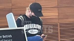 Logan Paul Sports Broken Arm in Cast at Berlin Airport